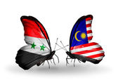 Butterflies with Syria and Malaysia flags on wings — Stock Photo