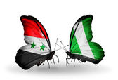 Butterflies with Syria and Nigeria flags on wings — Stockfoto