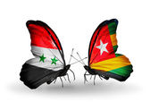 Butterflies with Syria and Togo flags on wings — Stockfoto