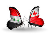 Butterflies with Syria and Tonga flags on wings — Foto Stock