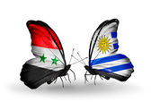 Butterflies with Syria and Uruguay flags on wings — Foto Stock