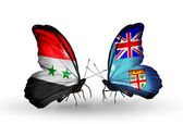 Butterflies with Syria and Fiji flags on wings — Stok fotoğraf