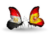 Butterflies with Egypt and Spain flags on wings — Stok fotoğraf