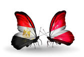 Butterflies with Egypt and Latvia flags on wings — Photo