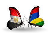 Butterflies with Egypt and Mauritius flags on wings — Stock Photo