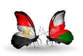 Mariposas con banderas de egipto y omán en alas — Foto de Stock
