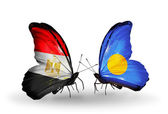 Butterflies with Egypt and Palau flags on wings — Стоковое фото