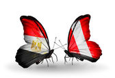Butterflies with Egypt and Peru flags on wings — Stock Photo