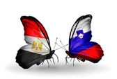 Butterflies with Egypt and Slovenia flags on wings — Stock fotografie
