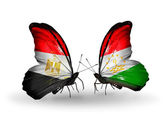 Butterflies with Egypt and Tajikistan flags on wings — Стоковое фото