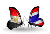 Butterflies with Egypt and Thailand flags on wings — Stock Photo