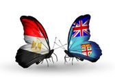 Butterflies with Egypt and Fiji flags on wings — Stock fotografie
