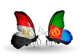 Butterflies with Egypt and Eritrea flags on wings — Stock Photo
