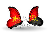 Butterflies with Vietnam and Angola flags on wings — Стоковое фото