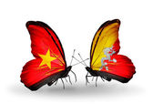 Butterflies with Vietnam and Bhutan flags on wings — Stock fotografie