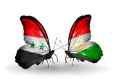 Butterflies with Syria and Tajikistan flags on wings — Stockfoto