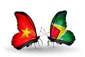 Dos mariposas con banderas de vietnam y guyana — Foto de Stock