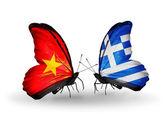 Dva motýli s příznaky vietnamu a řecko — Stock fotografie