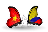 Two butterflies with flags  of Vietnam and Columbia — Photo