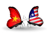 Two butterflies with flags  of  Vietnam and Liberia — Photo