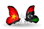 Two butterflies with flags  of  Vietnam and Libya — Stock Photo