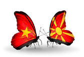 Two butterflies with flags  of Vietnam and Macedonia — Stock Photo