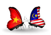 Two butterflies with flags  of Vietnam and Malaysia — Stock Photo