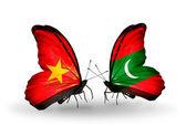 Två fjärilar med flaggor av vietnam och Maldiverna — Stockfoto