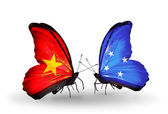 Two butterflies with flags  of  Vietnam and Micronesia — Photo
