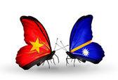 Due farfalle con bandiere del vietnam e isole marshall — Foto Stock