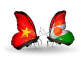 Two butterflies with flags  of Vietnam and Niger — Stock Photo