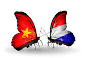 Two butterflies with flags  of  Vietnam and  Holland — Stock Photo