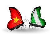 Dos mariposas con banderas de vietnam y nigeria — Foto de Stock