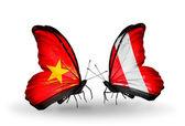 Dos mariposas con banderas de vietnam y perú — Foto de Stock