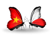 Two butterflies with flags  of Vietnam and Poland — Stock Photo