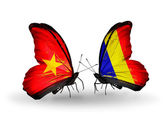 Two butterflies with flags  of Vietnam and Chad, Romania — Stock Photo