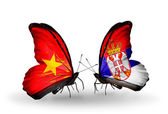 Two butterflies with flags  of Vietnam and Serbia — Stock Photo