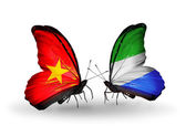 Two butterflies with flags  of  Vietnam and Sierra Leone — Стоковое фото