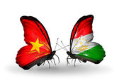 Two butterflies with flags  of Vietnam and Tajikistan — Stock Photo