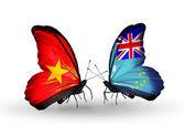 Dos mariposas con banderas de vietnam y tuvalu — Foto de Stock