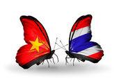Dos mariposas con banderas de vietnam y tailandia — Foto de Stock