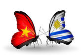 Two butterflies with flags  of  Vietnam and Uruguay — Photo