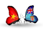 Two butterflies with flags  of Vietnam and Fiji — Foto Stock