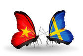 Two butterflies with flags  of Vietnam and Sweden — Stock Photo