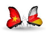 Dos mariposas con banderas de vietnam y osetia del sur — Foto de Stock