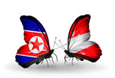 Two butterflies with flags  of North Korea and Austria — Photo