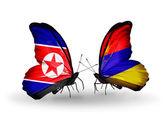 Dos mariposas con banderas de corea del norte y armenia — Foto de Stock