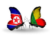 Butterflies with North Korea and Benin flags on wings — Stock Photo