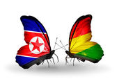 Butterflies with North Korea and Bolivia flags on wings — Stock Photo