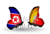 Butterflies with North Korea and Bhutan flags on wings — Stock Photo
